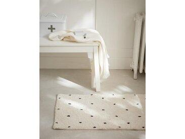 Tapis de bain à pois blanc/pois noir