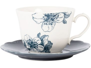 Tasse et soucoupe en faïence blanche et bleue imprimé floral