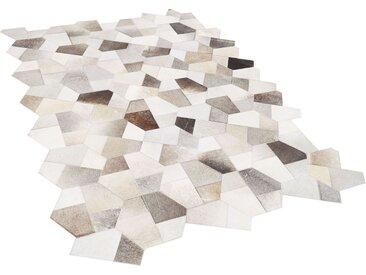 Tapis patchwork design gris et beige en peau de vache naturelle