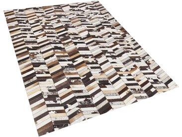 Tapis rectangulaire à motif zigzag en peau de vache marron et blanc cassé